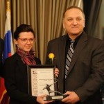 Anna Kiryakova / Mikhail Farfel recieve Silver Archer award on behalf of IPFF in Washington, DC on January 29, 2016